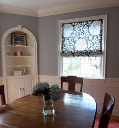 Cheerful gray dining room: Benjamin Moore's AC-28 Smoke Embers ( a central grey - not a blue/lavender or green grey :) and Navijo White