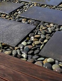 Favorite look for a path in side yard... if stones closer together and pea gravel in between, could even put dining table and chairs out there!