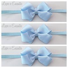 Headband/faixa de cabelo com laço em gorgurao azul. <br>pode ser feito em elastico ou bico de pato. <br>10% de desconto nesse valor caso o pagamento seja deposito em conta.