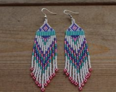 These hand made, traditionally crafted, native beaded design earrings with your choice of Hypo allergenic, sterling silver plated or Rose gold plated ear wires and dangle 3 or 4 inches long. They are sure to be a unique eye catcher. Made in the Yukon, Canada by Suzanne Flumerfelt.