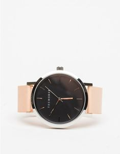 A simple and clean, oversized wrist watch from The Horse with a polished stainless steel case. Features a large case and a naturally tanned vegetable dyed strap that will develop a natural patina over time.   •Minimal, oversized wristwatch  •Genune