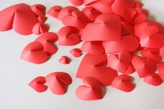 Make a wall of paper hearts   How About Orange