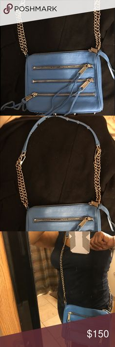 Lovely blue Rebecca Minkoff 3 zipper crossbody!😍 Gorgeous summer blue 3 zipper crossbody! 100% authentic Minkoff from Nordstrom! Only used one summer then placed in storage. Older version. No inside pockets. The top zipper on the outside is the only pocket. Straps can be doubled to use as a small shoulder bag. I'm sorry for the bad modeling but you can see for yourself. GUC but some slight wear. I don't see the dust bag but if I find it, I'll send it. Measurements in comments. 🚫No trades…