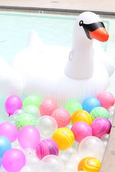 Swan pool float swim pool birthday party ideas- easy summer girl birthday party to pull together
