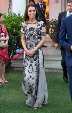 April 11, 2016 At a party in honor of the Queen's 90th birthday, she wore a two-piece set, an embroidered crop top and midi-length skirt, by another one of her favorite designers Alice Temperley.