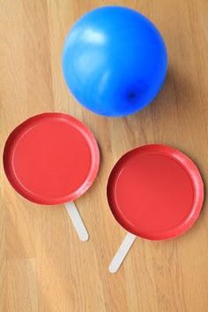 You can make paper plate paddles for balloon tennis. Trim off the outer 1/2 inch and hot glue on some large craft sticks. Balloon tennis is great! It kept the kids entertained for a long time! These are a keeper! ~ Ever Never Again