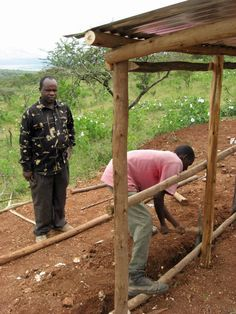 Fundi is digging trenches and placing iron sheets to build this chicken coop near Bisil school.