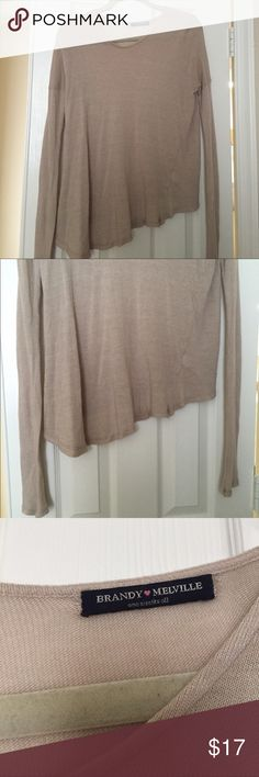 Brandy Melville sweater Brandy Melville. Tan color. Hem is shorter on one side (not high low). No size. 100% cotton so no pilling! Brandy Melville Sweaters Crew & Scoop Necks