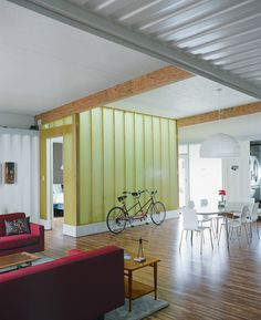 The light wall around the master bedroom, made from Enduro Systems fiberglass, is a light turquoise on the bedroom side, amber on the living room side, and glows green at night when the lights between the two ...