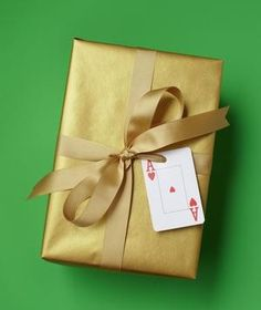 A playing card is a clever stand in for a gift card!  Repurpose an everyday item.