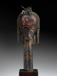 Fang peoples, Betsi group TITLE Reliquary Head DATE 1875–1925 MEDIUM Wood and feathers DIMENSIONS Overall: 13 1/4 x 4 3/4 x 2 3/4 in. (33.7 x 12.1 x 7 cm)   MFAH | The Museum of Fine Arts, Houston