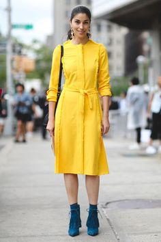 Yellow and teal make a cheery combination. #refinery29 http://www.refinery29.com/2015/09/93788/ny-fashion-week-spring-2016-street-style-pictures#slide-116