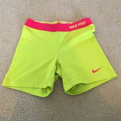 Nike Pro Compression Shorts Nike pro neon compression shorts. Really good condition, I just don't really wear them. Nike Shorts
