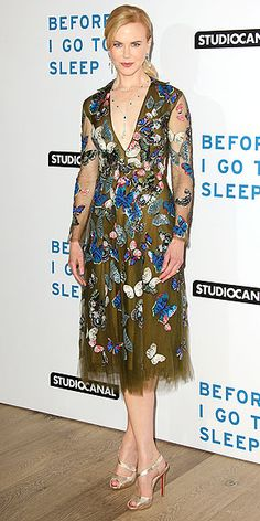 NICOLE KIDMAN The actress's Valentino dress might have a dramatic super-low neckline, but embroidered sparkly butterflies and sheer sleeves add an element of whimsy to the silhouette. She accessorizes with silvery Christian Louboutin heels and a delicate Fred Leighton necklace for a Before I Go to Sleep screening in London.