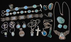 ANCIENT ROMAN GLASS JEWELRY - Silver jewelry set with fragments of ancient Roman glass. The shards of glass were unearthed in archeological excavations in the Holy Land which was part of the Roman Empire 2,000 years ago. The jewelry, which was designed and handmade in Israel, consists of pendants, bracelets, necklaces, rings, pins and earrings.
