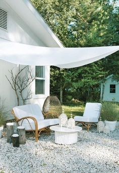 (via outdoor spaces in white | the style files) - how simple is this to create shade
