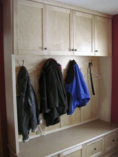 Custom mudroom coat rack with bench seating and cubbies for every family member.