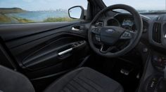 Ford Kuga interior, front seat, steering wheel and dashboard