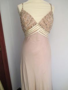 Champagne chiffon with spaghetti straps and beaded bodice. simply beautiful and elegant