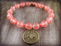 Leo Charm Bracelet Zodiac Beaded Stretch Bracelet Beadwork Astrology Star Sign Leo Lion Pink Glass and Seed Beads Bronze Jewelry #accessories #hepteam