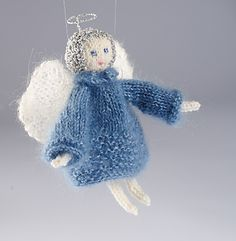 To make this super cute Angel's dress, use a double strand of Angel, or another lace weight yarn. The wings are knitted using a single strand and wired around the edge with knitting wire or florist's wire. The halo is again made with wire, wrapped in lurex yarn.