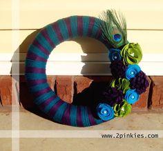 """Peacock Yarn Wreath - 14"""", felt flowers, peacock feather. $50.00, via Etsy."""