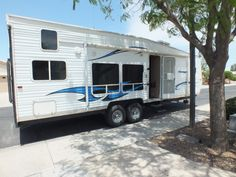 See how a designer transformed her 2006 travel trailer into her very own tiny… Toy Hauler Camper, Camper Trailer For Sale, Diy Camper, Rv Homes, Camper Renovation, Camper Remodeling, Travel Trailer Remodel, Airstream Interior, Camper Makeover
