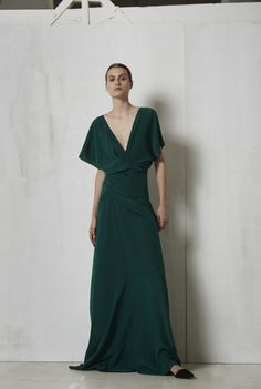 950€  Long silk dress cut on the bias and with butterfly sleeves. The dress crosses at the front and has a V shaped neckline. This dress in available in red and in green.  100% Italian silk.  Crafted in Barcelona.