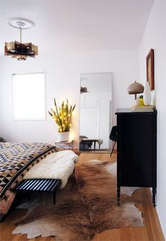 masculine and chic..cowhide rugs also available at www.ecowhides.com