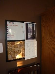 Easy way to makeover an old bulletin board - add stickers for a weekly menu planner, attach wine corks, and add hooks for keys, calendars, and anything else you need easy access to