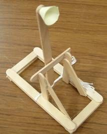 Fabulous DIY torsion catapult. Requires operation of hot glue gun, so for 9 and over.