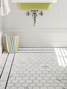 Add a luxurious feel underfoot in the bathroom with mesh-backed marble tile featuring impressive 3-inch hexagons.