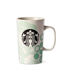 Brighten your day with a coffee mug blossoming with fresh signs of spring.