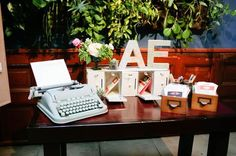 A lovely card table with a lovely Hermes 3000 Typewriter.  Don't get married without one!