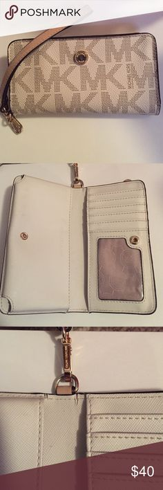 Michael Kors Wrislet In good used condition! Definitely practical for a night out or for everyday use! There is a phone slot(my iPhone 6 fits in it w case!), ID slot, multiple card slots and a slot for cash! , there's also a back zipper compartment. Signs or wear are on the hardware on the front and pictured inside. Wrislet strap is detachable Feel free to ask questions Michael Kors Bags Clutches & Wristlets