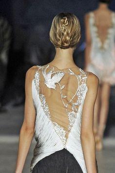 Alexander McQueen haute dress.  Back detail.  Bird and flower embroidered on sheer.  Silk fringe.