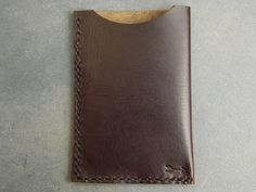This minimalist card holder / slim wallet was made entirely by hand using high…