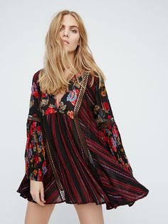 Just The Two Of Us Mixed Printed Tunic | Printed crinkly babydoll style swing tunic featuring crochet insets and pleat detailing. V-neckline and elastic cuffs with wide statement sleeves.