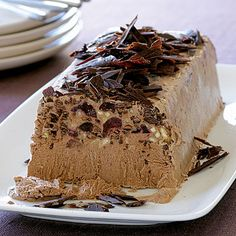 Chocolate-Amaretto Semifreddo by Sunset Magazine. Studded with dark cherries and toasted almonds and flavored with amaretto, this creamy Italian chocolate amaretto semifreddo is a cinch to make. Greek Desserts, Italian Desserts, Frozen Desserts, Frozen Treats, Italian Chocolate, Chocolate Coffee, Chocolate Desserts, Chocolate Custard, Frozen Chocolate