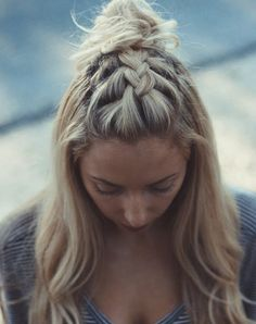 French braid topknot. Get this and more beautiful fall braids to add to your seasonal beauty rotation. #braids #braidedhairstyles #fall #hairstyles #hairstyleideas #braidideas