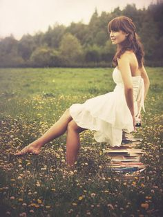 I want to be barefoot, outside, sitting on books, in a field of flowers.