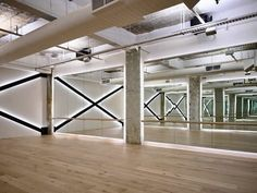 Revelling in the rawness, design studio give pioneering fitness centre Raw Studios Melbourne an unconventional look...