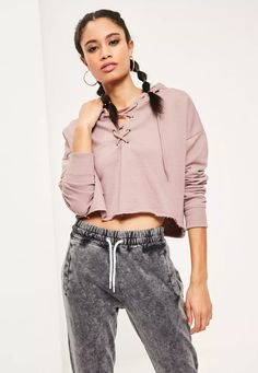 For one of those lazy days - turn to this dreamy mauve cropped hoodie! With lace up detail to the front, this piece is perfect to throw on and go!