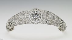 The bandeau, Queen Mary diamond bandeau tiara, chosen from Her Majesty's collection, is formed as a flexible band of eleven sections, pierced with interlaced ovals and pavÈ set with large and small brilliant diamonds