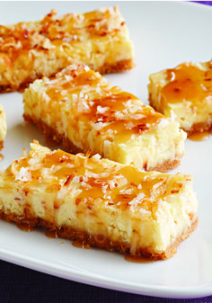 Coconut Cheesecake Squares with Caramel Topping – With their shortbread cookie crust and drizzle of warm caramel topping, this coconut cheesecake squares recipe are sure to be requested again…and again!