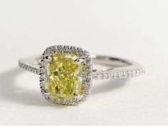 Cushion Cut Halo Diamond Engagement Ring in Platinum #BlueNile. I normally wouldn't go for a yellow engagement ring, but this is so gorgeous!