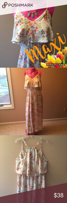 LC Lauren Conrad Floral Maxi Floral print Maxi by Lauren Conrad. Flutter detail on the top wraps around the whole dress. Very pretty for a bridal/baby shower, Easter or a spring date! LC Lauren Conrad Dresses Maxi