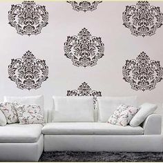 I want to do this to my wall to bring in some colors without completely repainting - I saw stencils at Hobby lobby similar to this for like $16 the other day. Would be so easy.