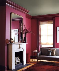 This combination of berry walls, a putty ceiling, and burgundy trim is nothing if not dramatic.