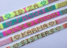 Stylish neon and pastel colored summer quote Miyuki bead loom bracelets by jewelry brand Chanelery.  Letters are made out off 24k solid golden beads.  All bracelets are handmade loom beaded with miyuki beads and finished with 18k filled gold plated clasps,locks and adjustable chain.